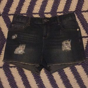 Justice jean shorts w/ sparkly patches under rips